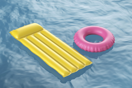 lilo: Pool raft and swim ring floating on wavy water
