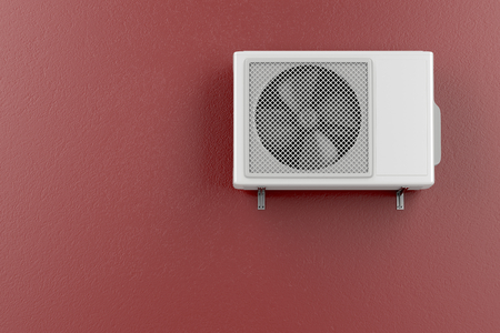 mounted: Air conditioner mounted on the red wall