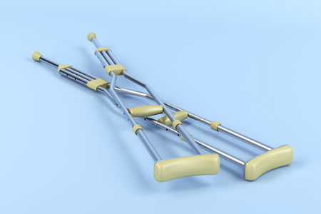 axilla: Pair of underarm crutches on blue background