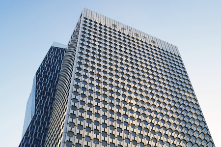 skyscraper skyscrapers: PARIS, FRANCE - SEPTEMBER 29, 2015: Tour Ariane is an office skyscraper located in La Defense business district in Paris, France Editorial
