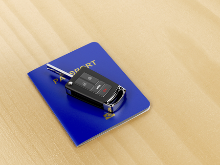 keyless: Car key and passport on wooden table