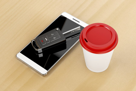 keyless: Smartphone, car key and coffee cup on wooden table  Stock Photo