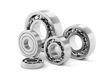 Group of ball bearings with different sizes on white background  Stock Photo