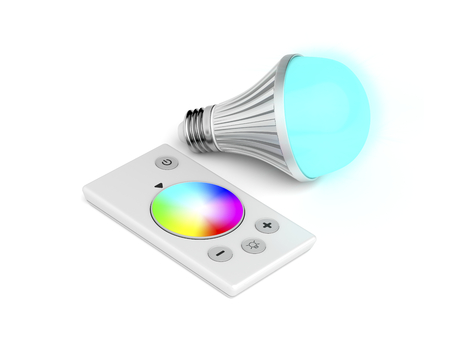 Remote control and color changing LED light bulb Stock Photo