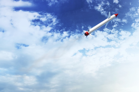 Cruise missile flying in the sky Stock Photo