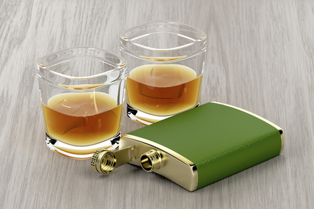 Green hip flask and two glasses of whisky on wooden table Stok Fotoğraf