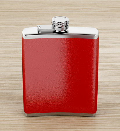 Front view of red hip flask on wooden table Stok Fotoğraf