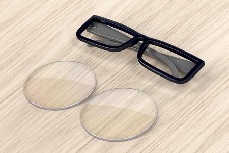 Plastic eyeglasses frame and uncut lens on wood background