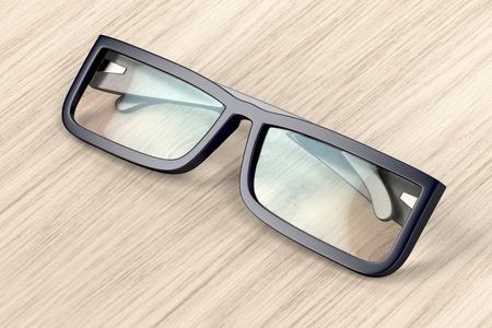 Eyeglasses with black frame on wood background Stock Photo