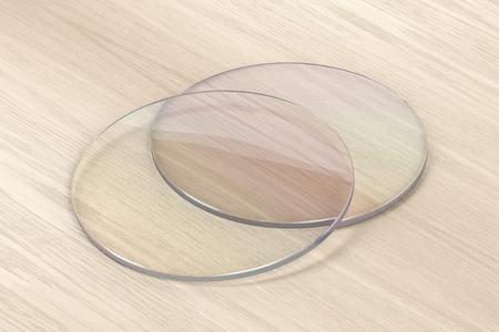 Pair of eyeglasses lens on wood background