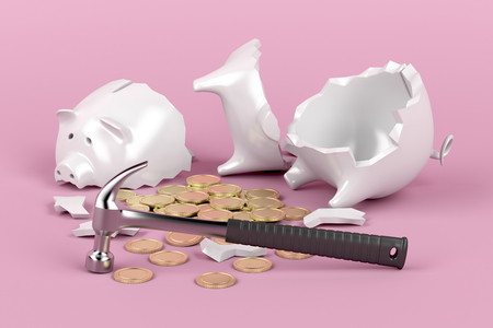 Broken piggy bank with hammer on pink background