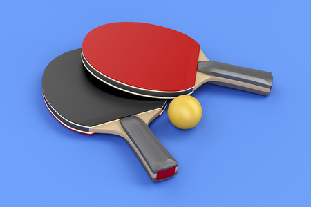 Pair of table tennis rackets and ball on blue background