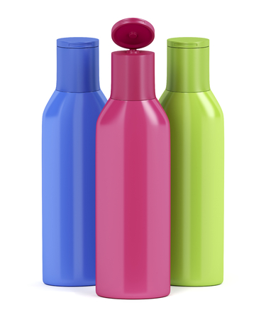 Three plastic bottles for cosmetic liquids with different colors 스톡 콘텐츠