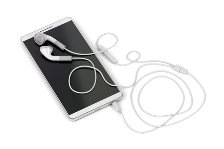 Smartphone and wired earphones on white background Stockfoto