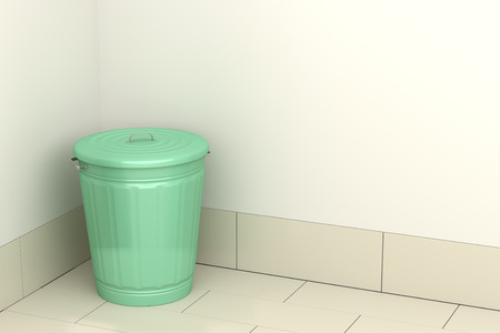 Green garbage bin in the room