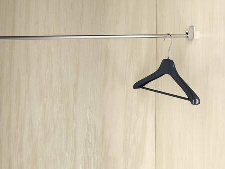 Empty hanger in the wardrobe