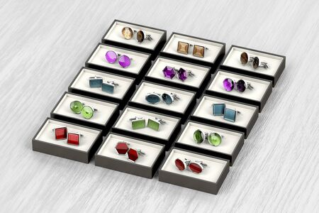 Rows of different designs of cufflinks
