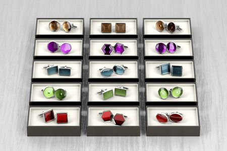 Group of different cufflinks on wood table