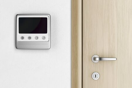 Video intercom near the entrance door in the apartment, front view