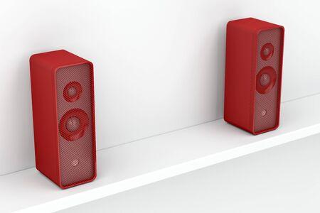 Red stereo speakers on white shelf