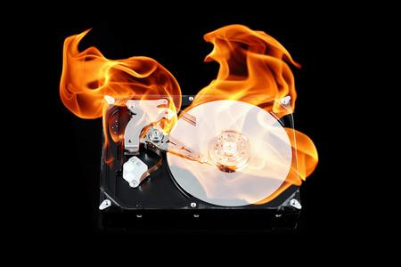Opened external hard drive on fire. Hard disk failure. Data loss concept, computer crash