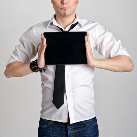 Business man holding and shows touch screen tablet pc with blank screen. photo