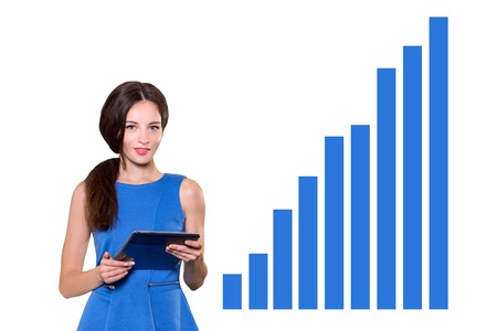 Accountant: Young businesswoman holding the tablet smiling at camera isolated on white background with growing forecast statistics. Success, creative and start up concept. Copy space for your text Stock Photo