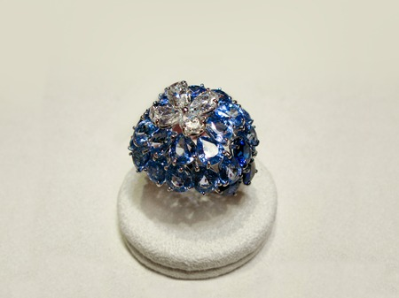 white gold: Luxury jewellery. White gold or silver ring with blue gems. Selective focus Stock Photo