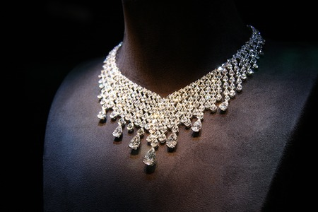 diamond background: Necklace made of white gold with diamonds on a stand