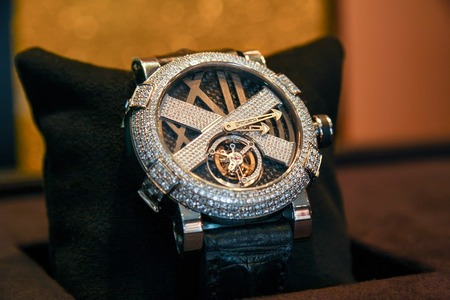 Swiss watches on stand. Men fashion. Men or women accessories. Selective focus