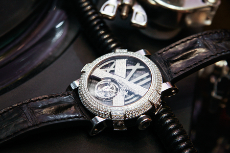 Swiss luxury watch with diamonds on the table. Men fashion. Men or women accessories Stock Photo