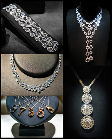 jewelry: Set of luxury jewelry made of white gold or silver and diamonds. Luxury women accessories on stands Stock Photo