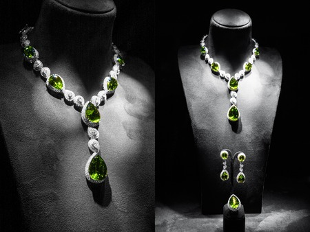 jewelry: Set of luxury jewelry made of white gold with diamonds and emeralds on a stand Stock Photo