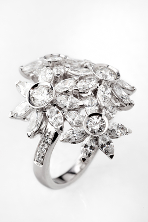 white gold: White gold or silver ring with diamonds on white background