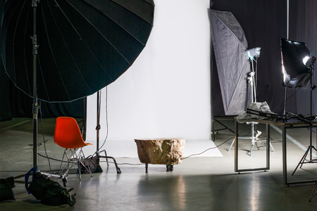 Empty photo studio with modern interior and lighting equipment