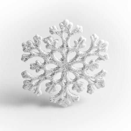 white winter: White Snowflake on a white background. Winter symbol. Stock Photo