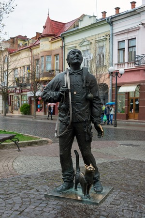 chimney sweep: Monument of Happy Chimney Sweeper and his cat. The monument with real chimney sweeper Bertalon Tovt as prototype was unveiled on June 12, 2010 by Ukrainian sculptor Ivan Brovdi Stock Photo