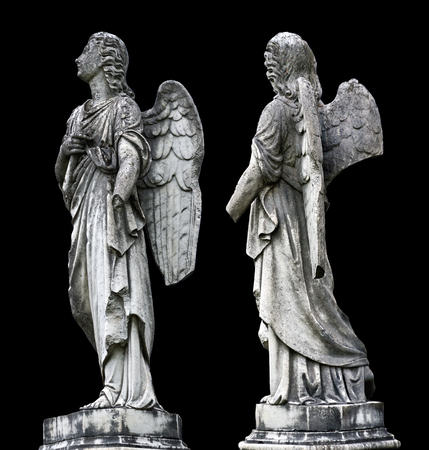 stone tombstone: Old tombstone sculptures of an angel with broken arm and wings isolated on black Stock Photo