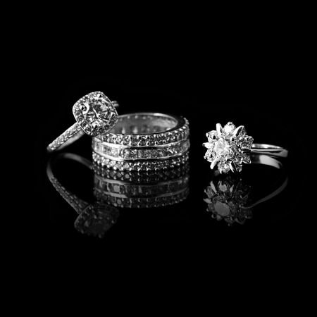 Luxury jewellery. White gold or silver rings with diamonds. Selective focus.