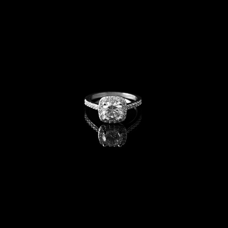 Luxury jewellery. White gold or silver ring with diamonds. Selective focus.