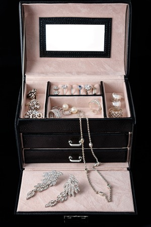 silver jewelry: Jewelry box with white gold and silver rings, earrings and pendants with pearls. Collection of luxury jewelry
