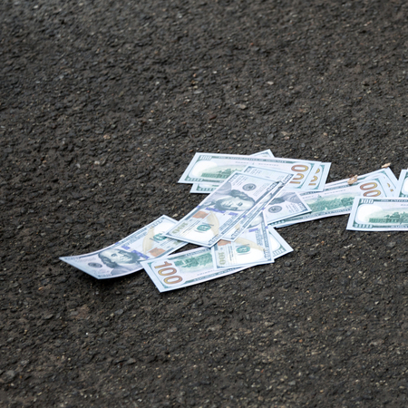 multiple birth: Dollars lying on the ground. American money new hundred dollar bills