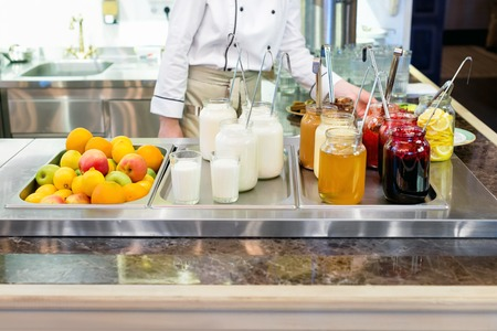 checking ingredients: Food at restaurant kitchen. Chef checking meal ingredients Stock Photo