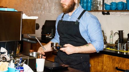 hand press: Barista making coffee using press for ground coffee