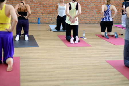 abductor: Young women do yoga indoors. Selective focus