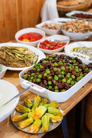 Olives and vegetable snacks in the restaurant