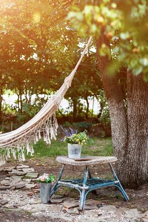 Hammock in the summer garden, sunny day. Selective focus Standard-Bild