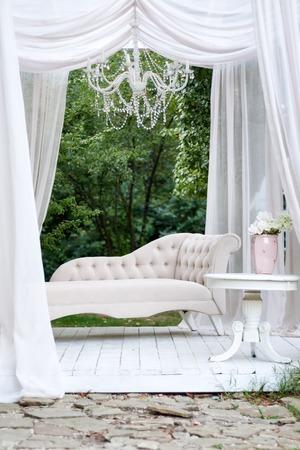 seating area: Beautiful garden seating area with modern white sofa, canopy and garden tea table, gazebo decor idea