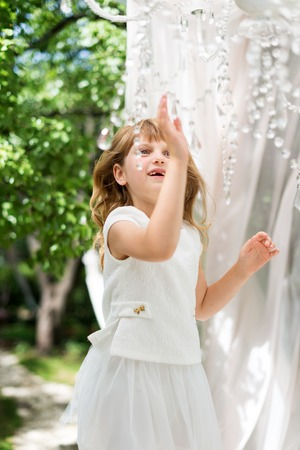 chandelier  kids: Little girl having fun outdoor in the gazebo. Child playing, garden playground. Stock Photo
