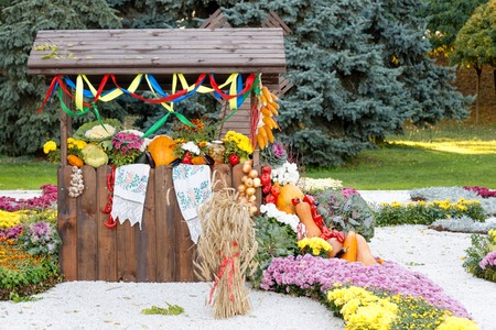 pavilion: Harvest vegetables on fair trade in a wooden pavilion. Seasonal traditional ukrainian exhibition of farmers achievements. Agricultural products, rural market
